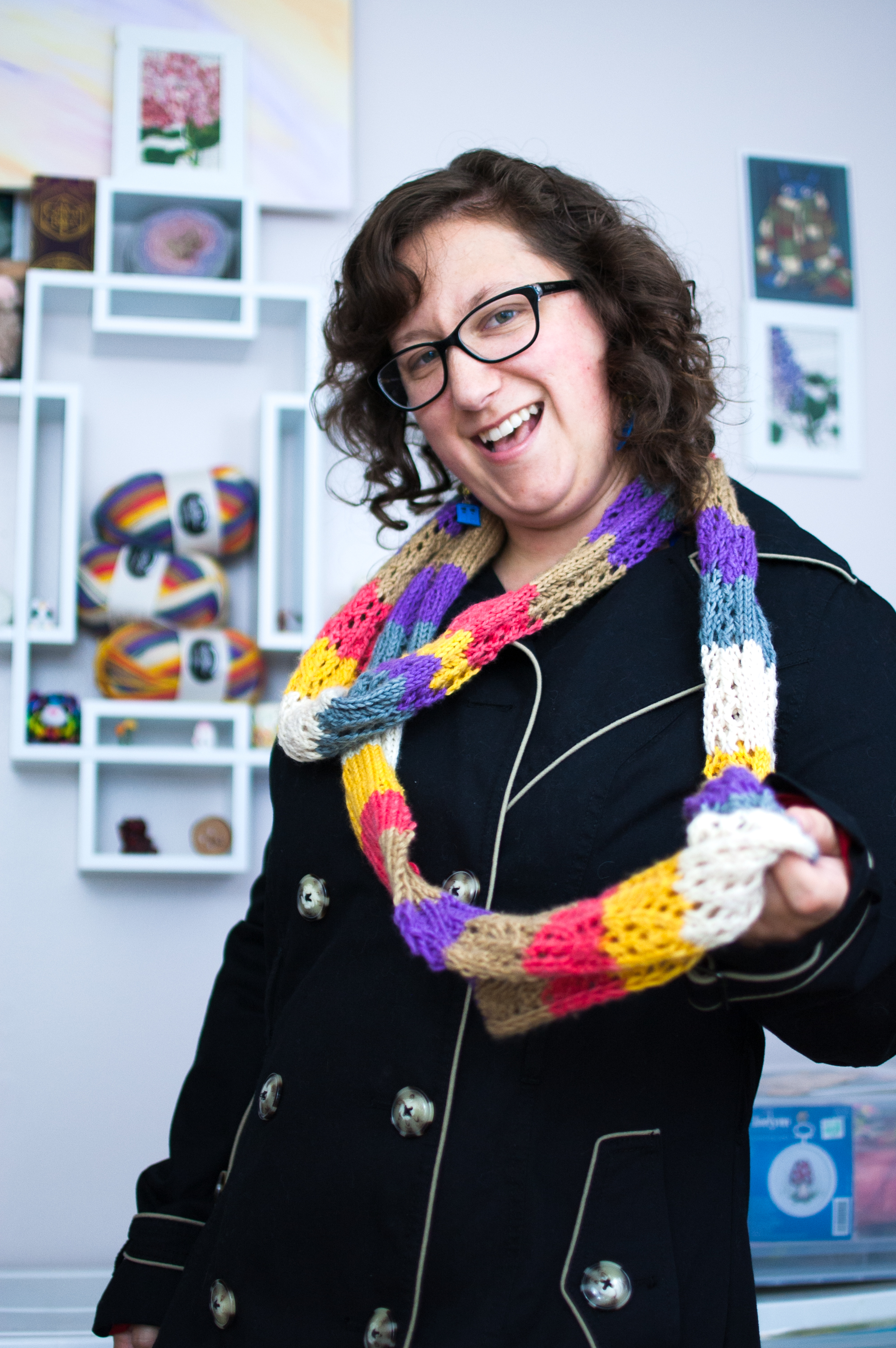 A geeky knitter wearing a fancy Doctor Who-inspired knitted scarf